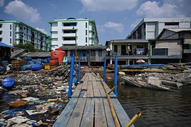 In this picture taken on July 12, 2019, houses and apartments are under the sea level as seen in northern Jakarta. Indonesia's capital is being swallowed into the ground at such an alarming rate that experts warn much of it could be submerged by 2050. AFP