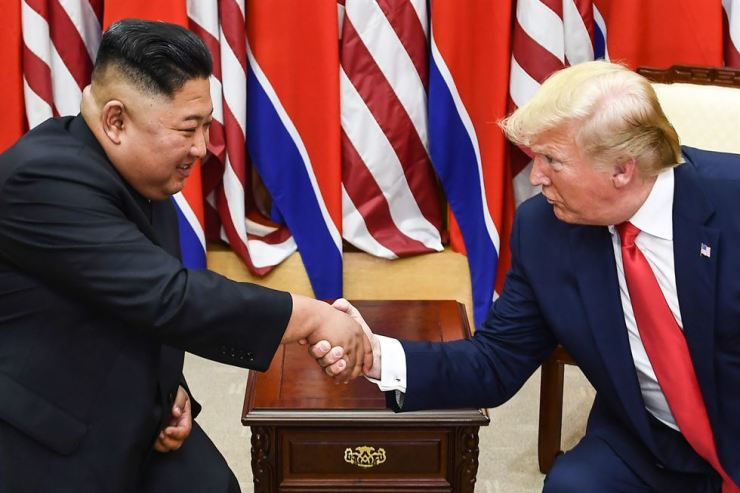 In this file photo taken on June 30, 2019, North Korea's leader Kim Jong-un and U.S. President Donald Trump shake hands during a meeting on the south side of the Military Demarcation Line that divides North and South Korea. AFP