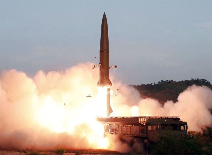 North Korea on Tuesday fired unidentified projectiles twice into the sea while lashing out at the United States and South Korea for continuing their joint military exercises that the North says could derail fragile nuclear diplomacy. Yonhap