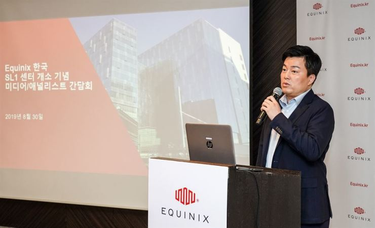 Chris Jang, country manager of Equinix Korea, speaks during a media conference at the Plaza Hotel in central Seoul, Friday. / Courtesy of Equinix Korea