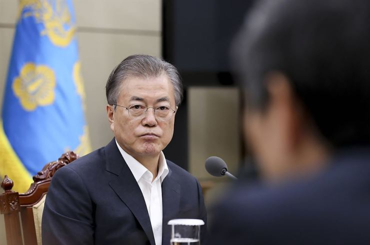 In this photo provided by Cheong Wa Dae, President Moon Jae-in listens to a report from officials about the General Security of Military Information Agreement (GSOMIA) at Cheong Wa Dae in Seoul, Aug. 22. AP-Yonhap