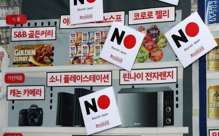 A poster identifying Japanese products with 'Boycott Japan' stickers on them / Korea Times file