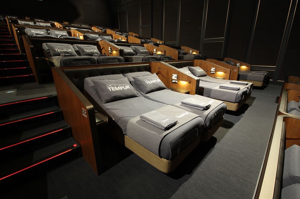 An image of CJ CGV's Tempur Cinema which provides a new level of luxury with reclining beds and full concierge service. Courtesy of CJ CGV