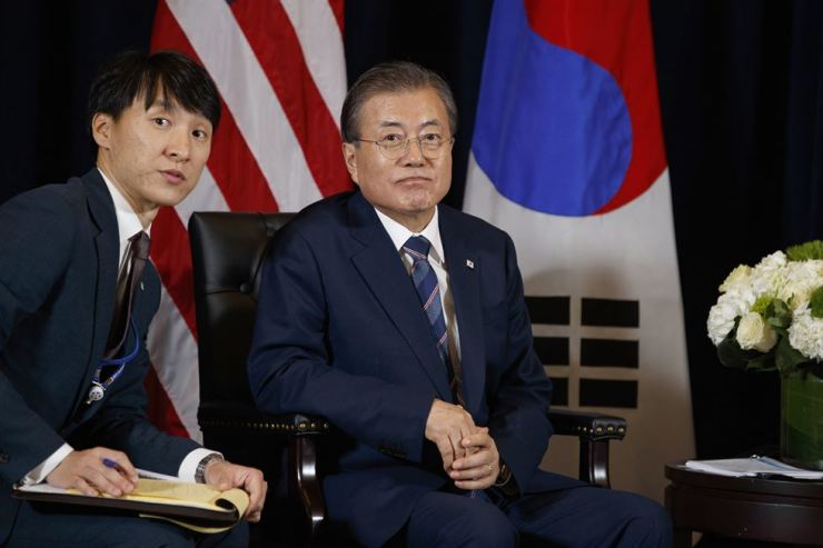 President Moon Jae-in and his interpreter listen to a question during a meeting with U.S. President Donald Trump at the InterContinental Barclay hotel during the United Nations General Assembly in New York, Monday, Sept. 23, 2019. AP