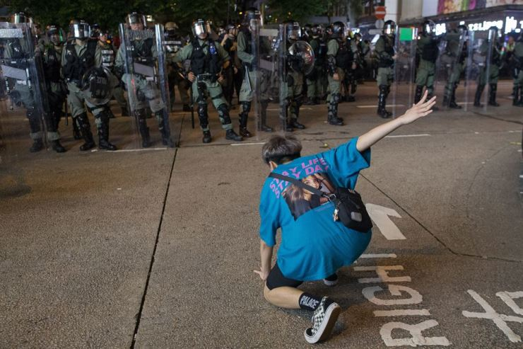 A protester makes some dance moves in front of a row of anti-riot police during a clearing operation in Mongkok, Hong Kong, Sept. 7. Hong Kong braces for another weekend of chaos as anti-government protesters target various locations. EPA