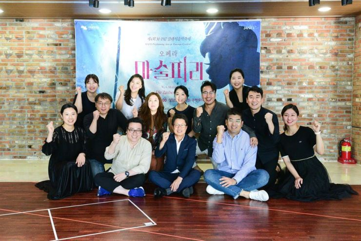 Opera singers pose for a photo with the director, conductor and CEO of the Mapo Cultural Foundation during a press conference on the production of Mozart's 'Magic Flute' on Aug. 29 at Mapo Art Center in Seoul. The opera will be held for two days on Sept. 6 and 7 at an outdoor theater at World Cup Park in Seoul. Courtesy of Mapo Cultural Foundation