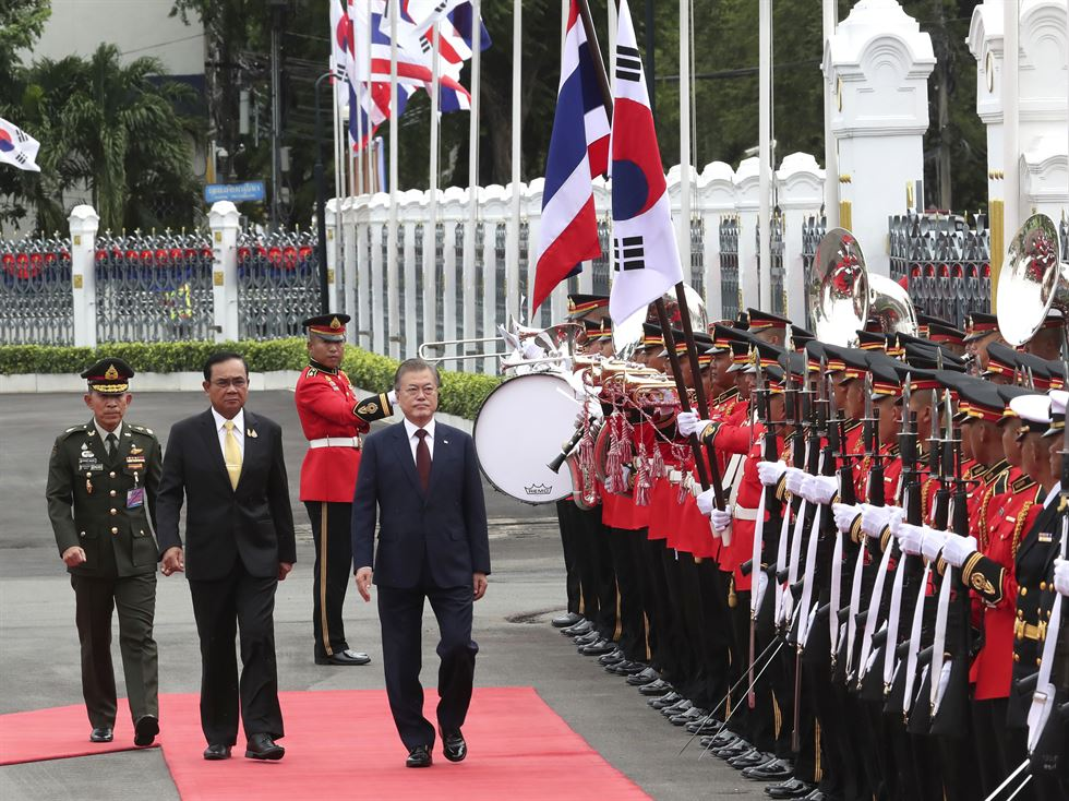 South Korean President Moon Jae-in, front, is shown the way by Thailand's Prime Minister Prayuth Chan-ocha during a welcoming ceremony at the government house in Bangkok, Thailand, Monday, Sept. 2, 2019. AP-Yonhap