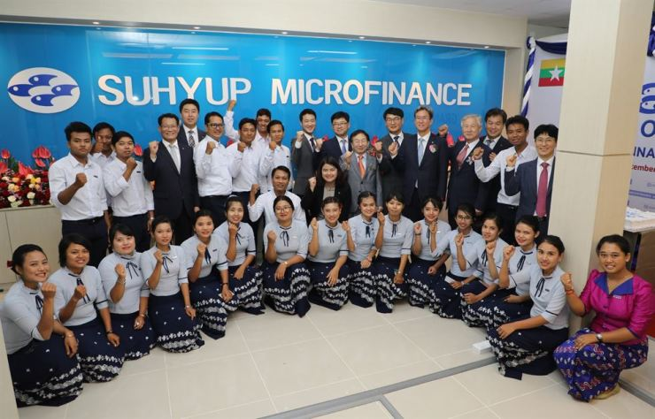 Suhyup Bank CEO Lee Dong-bin, second row fifth from right, poses with other officials and employees of Suhyup Micro Finance Myanmar at the subsidiary's office in Pyinmana, Monday. / Courtesy of Suhyup Bank