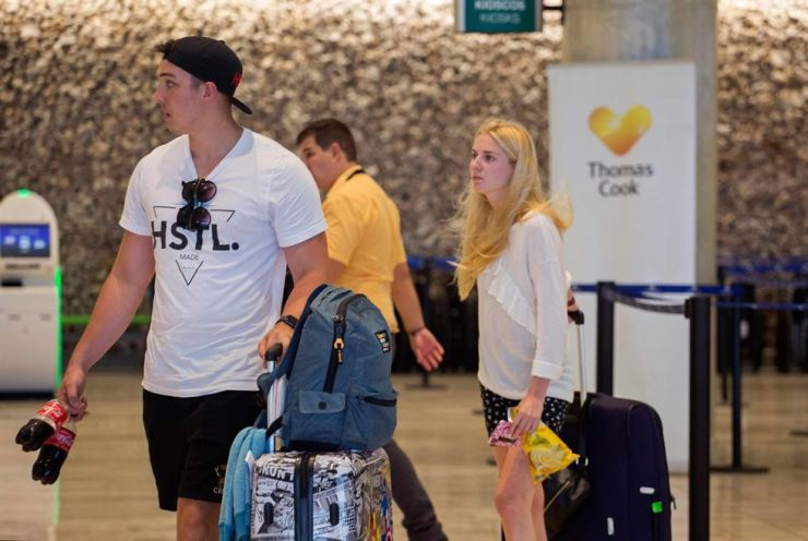 Passengers left stranded after the collapse of British travel firm Thomas Cook remain at Punta Cana's international airport, in the Dominican Republic, on Sept. 23, 2019. Thomas Cook, both a tour operator and an airline, collapsed on Monday, leaving hundreds of thousands of holidaymakers stranded worldwide and sparking the UK's biggest repatriation since World War II. AFP