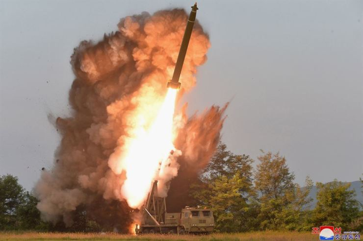 This Tuesday, Sept. 10, 2019, photo shows a test-firing from a multiple rocket launcher at an undisclosed location in North Korea. Korean Central News Agency reported that North Korean leader Kim Jong-un visited the site. AP