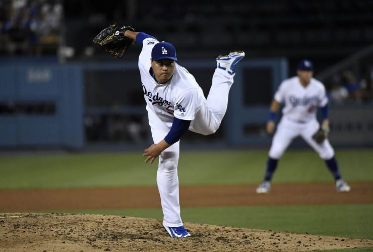 Pitcher Ryu Hyun-jin of the Los Angeles Dodgers throws against the Colorado Rockies during the fourth inning at Dodger Stadium on Wednesday in Los Angeles, Calif. /AFP-Yonhap