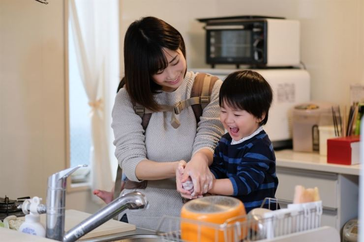 A toddler washes his hands with his mother in a kitchen. The Centers for Disease Control and Prevention Korea said washing hands is the easiest and most effective way to prevent various infectious diseases. Gettyimagesbank