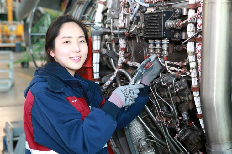 Lee Bo-hyun, a mechanic for Asiana Airlines, works on an engine of an Airbus A350 in the airline's second maintenance hangar at Incheon International Airport. Courtesy of Asiana Airlines