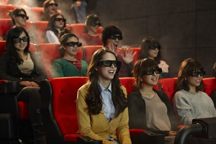 In this photo provided by CJ CGV, moviegoers experience 4DX at a theater. Courtesy of CJ CGV