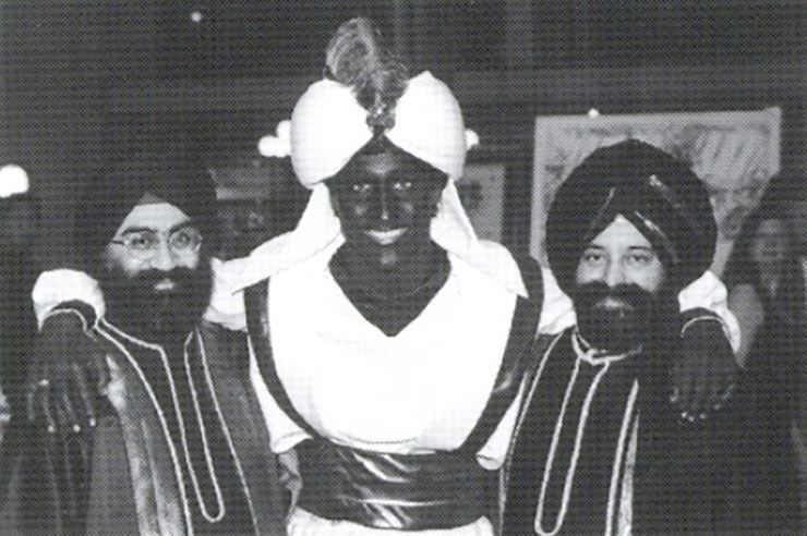 This April 2001 photo, which appeared in a newsletter from the West Point Grey Academy, shows a costumed Justin Trudeau, his face and hands darkened by makeup, attending an 'Arabian Nights' gala. The academy is a private school in Vancouver, B.C., where Trudeau worked as a teacher before entering politics. AP