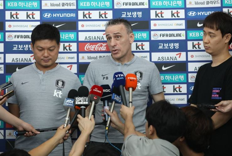 South Korea's national football team head chach Paulo Bento answers questions from journalists at the Incheon International Airport before leaving for Turkey. /Yonhap