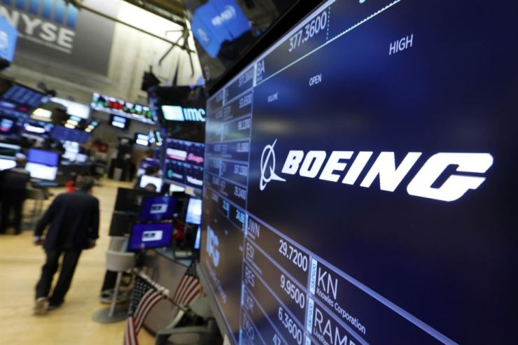 The logo for Boeing appears above a trading post on the floor of the New York Stock Exchange, Monday, July 22, 2019. AP