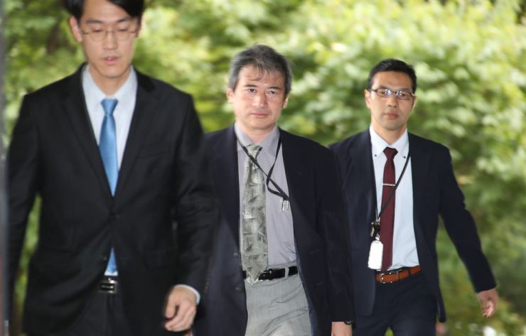 Taisuke Mibae, center, the minister of political affairs at the Japanese Embassy in Seoul, arrives at the South Korean Ministry of Foreign Affairs in Seoul, Friday, summoned over Japan's 2019 Defense White Paper published earlier the day. The Japanese annual defense paper claimed that South Korea's easternmost islets of Dokdo to be of Japan's territory, in the latest such claims through the paper in 15 consecutive years. Yonhap
