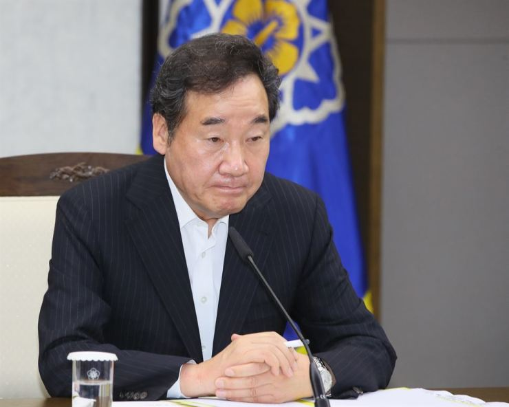 Prime Minister Lee Nak-yon participates in a ministerial meeting on Japan's trade regulations at the Sejong Government Complex, Tuesday. Yonhap