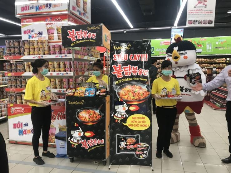 In this photo provided by Samyang Foods, models promote Buldak Ramen at a supermarket in Vietnam. / Courtesy of Samyang Foods