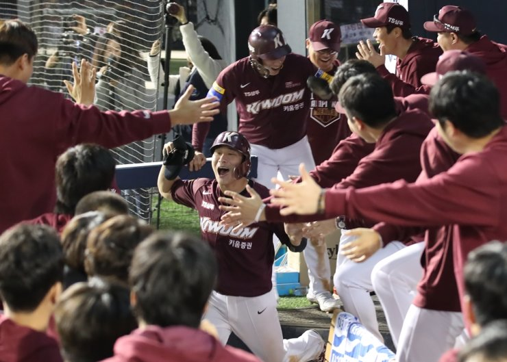 Members of the Kiwoom Heroes celebrate in Game 4 of their first-round playoff series in the Korea Baseball Organization at Jamsil Stadium in Seoul on Oct. 10. Yonhap