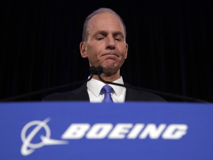 In this April 29, 2019, file photo, Boeing Chief Executive Dennis Muilenburg speaks during a news conference after the company's annual shareholders meeting at the Field Museum in Chicago. Boeing was aware of troubling instant messages between two employees regarding their communications with federal regulators over its now-grounded 737 Max jet, but the company waited months to disclose them. Federal Aviation Administration chief Steve Dickson demanded an explanation from Muilenburg in a letter Friday, Oct. 18. AP