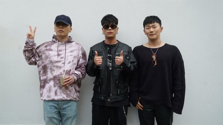 From left to right, Boi B, Geegooin and Hangzoo pose in front of the camera after an interview with the press for their first regular album 'Project A' which was released Sept. 24. /Courtesy of Amoeba Culture