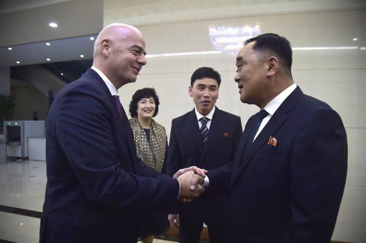 FIFA President Gianni Infantino, left, shakes hands with Kim Jang-san, secretary general of North Korean Football Association, upon his arrival at Pyongyang international airport in Pyongyang on October 15, 2019. AFP-Yonhap