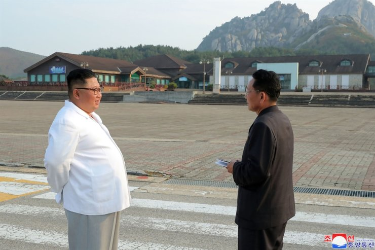 In this undated photo provided on Wednesday, Oct. 23, 2019, by the North Korean government, North Korean leader Kim Jong-un, left, visits the Diamond Mountain resort in Kumgang, North Korea. Korean Central News Agency-AP