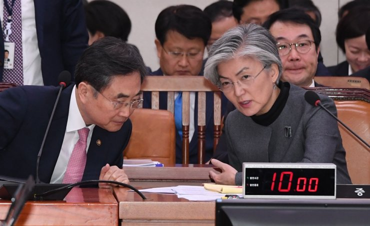 In October 2018, Cho Hyun, left, then-undersecretary of the Minister of Foreign Affairs, converses with the foreign affairs minister Kang Kyung-hwa during the National Assembly's audit on the ministry. Korea Times file