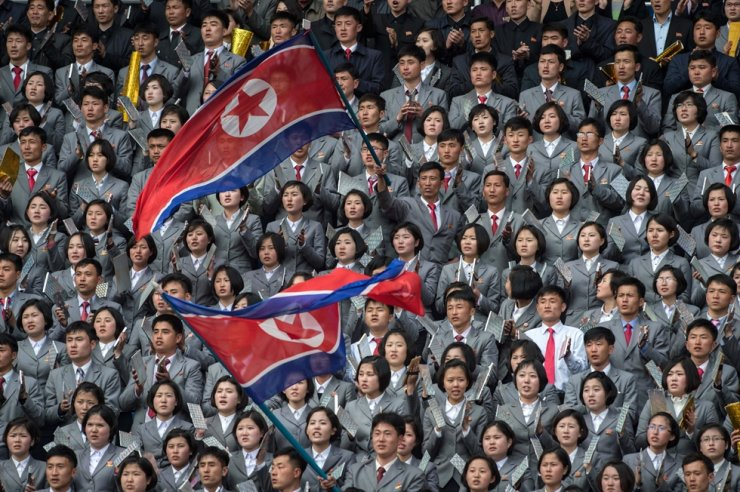 In this April 7, 2017 file photo, North Korean fans cheer their team against South Korea during their AFC Women's 2018 Asian Cup Group B qualifying football match at Kim Il-sung stadium in Pyongyang. North and South Korea face each other in a World Cup qualifier on Tuesday for their first ever competitive men's match in Pyongyang, while talks on the North's nuclear arsenal remain deadlocked. AFP-Yonhap