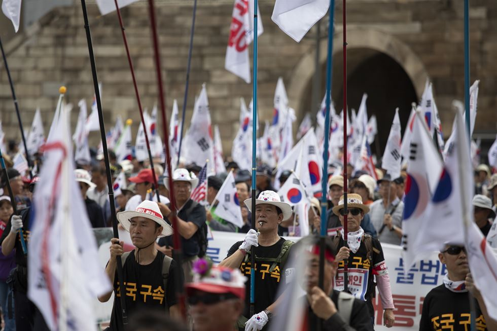 Protesters hold placards that read 'Moon Jae-in OUT,' at a rally against scandal-hit justice minister and President Moon in Seoul, Thursday. Korea Times photo by Choi Won-suk