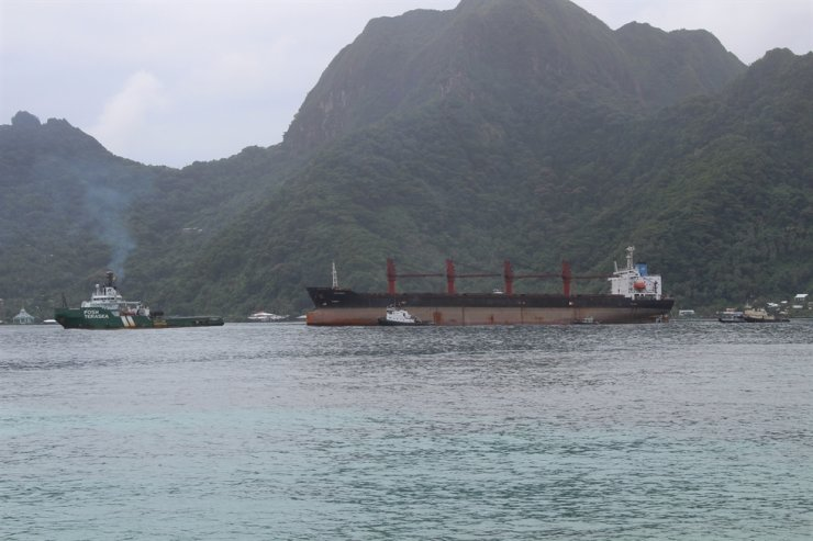 This May 11, 2019, file photo shows the North Korean cargo ship Wise Honest, middle, being towed into port in Pago Pago, American Samoa. The U.S. Coast Guard said the ship, which was suspected of being used to violate international sanctions, has been sold and towed from American Samoa. AP