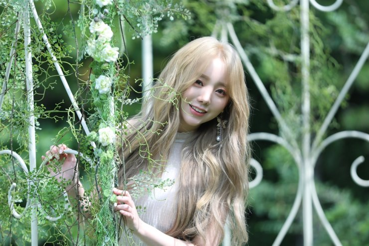 Kei, lead vocalist of K-pop girl band Lovelyz, released her first solo album 'Over and Over' on Tuesday. Courtesy of Woollim Entertainment