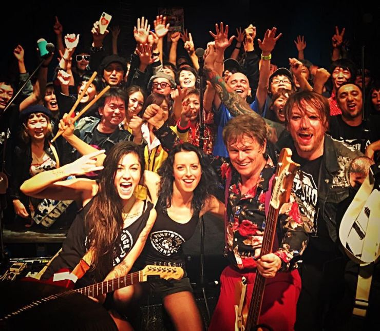 Duncan Reid, front row second from right, and the Big Heads pose with the audience at Namba Mele in Osaka during their Oct. 19 show. Courtesy of Sophie Powers