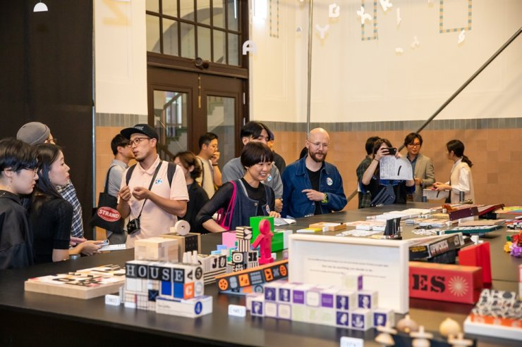 Visitors have a look around the 'Sundries' section of the 2019 Typojanchi: International Typography Biennale at Culture Station Seoul 284. Courtesy of Typojanchi