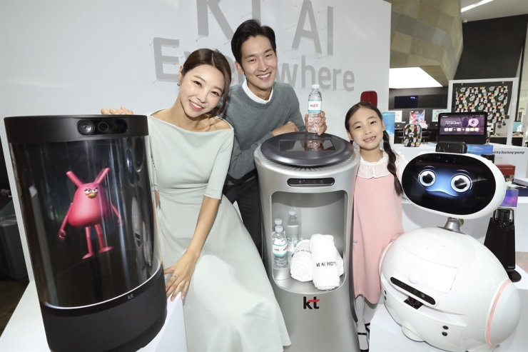 Models promote KT's various devices powered by artificial intelligence at a media conference at the firm's head office in Seoul, Wednesday. / Courtesy of KT