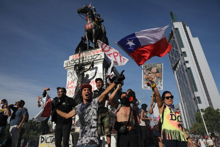 Anti-government protesters chant against President Sebastian Pinera in Santiago, Chile, Wednesday, Oct. 30, 2019. AP