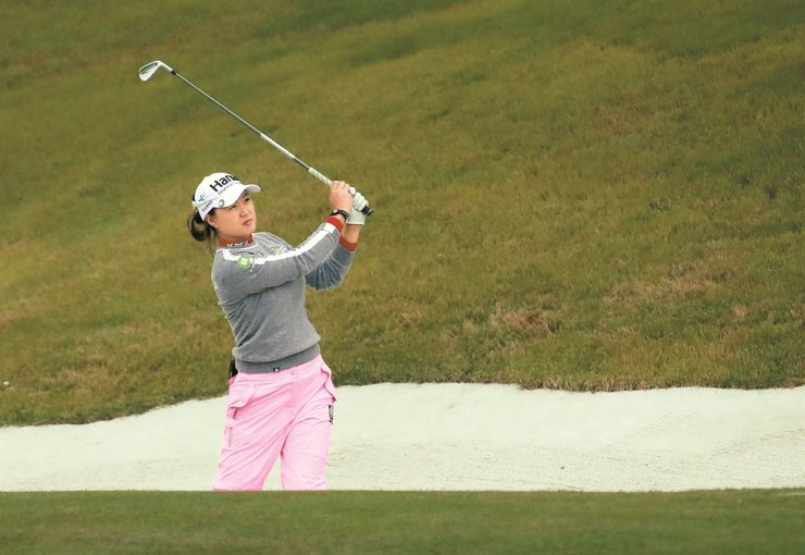 Lee Min-jee watches her tee shot at the 10th hole in the first round of the BMW Ladies Championship in Busan, Thursday. She led the round after hitting a 6-under 66. / Yonhap