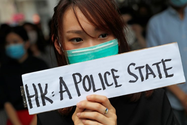 People attend a gathering to protest against what they say is the abuse of pro-democracy protesters by Hong Kong police, at Chater Garden in Central district, Hong Kong, Oct. 11, 2019. Reuters