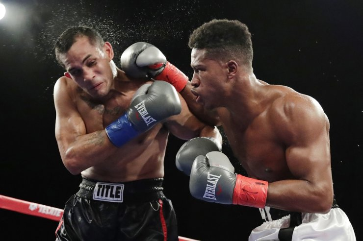 In this Oct. 27, 2018, file photo, Patrick Day, right, punches Elvin Ayala during the fifth round of a WBC super welterweight boxing bout in New York. Day won the fight. Day died Wednesday, Oct. 16, 2019, four days after sustaining head injuries in a fight with Charles Conwell. He was 27. AP