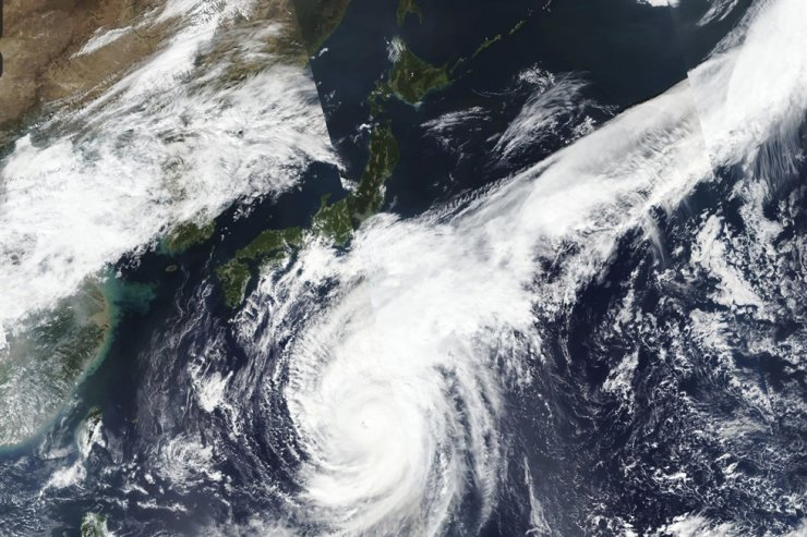 This Oct. 10, 2019, satellite photo shows Typhoon Hagibis approaching Japan. Japan's weather agency is warning it may bring torrential rains to central Japan over the weekend. NASA Worldview, Earth Observing System Data and Information System via AP