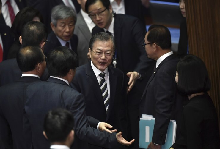 South Korea's President Moon Jae-in, center, leaves after delivering an annual budget address at the National Assembly in Seoul Tuesday, Oct. 22, 2019. AP-Yonhap