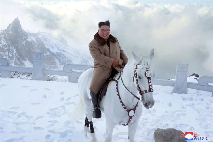 North Korean leader Kim Jong-un smiles while riding a white horse on Mount Paektu, the Korean Peninsula's highest peak, in footage released Wednesday by the North's KCNA. Yonhap