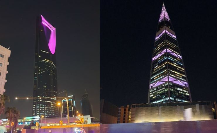 Kingdom Center, left, and Al Faisaliya Tower in Riyadh are lit with purple symbolizing BTS, Oct. 10, when the band held a concert in the Saudi Arabian capital. Yonhap