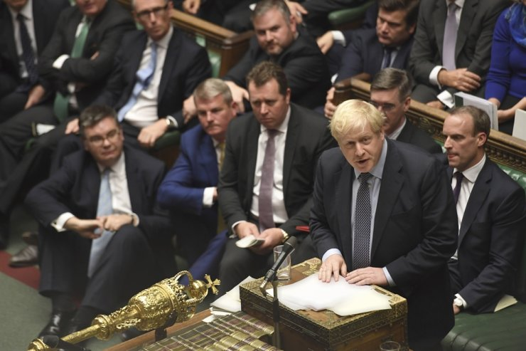 Britain's Prime Minister Boris Johnson speaks during the Brexit debate inside the House of Commons in London, Saturday, Oct. 19, 2019. At the rare weekend sitting of Parliament, Johnson implored legislators to ratify the Brexit deal he struck this week with the other 27 EU leaders. AP