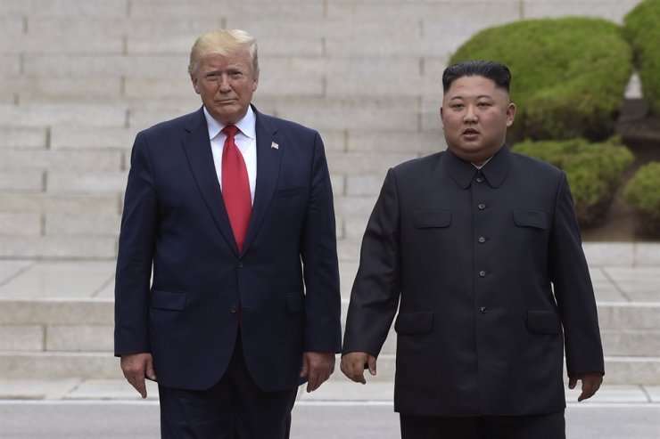 In this June 30 file photo, U.S. President Donald Trump, left, meets with North Korean leader Kim Jong-un at the North Korean side of the border at the village of Panmunjeom in the Demilitarized Zone. AP-Yonhap
