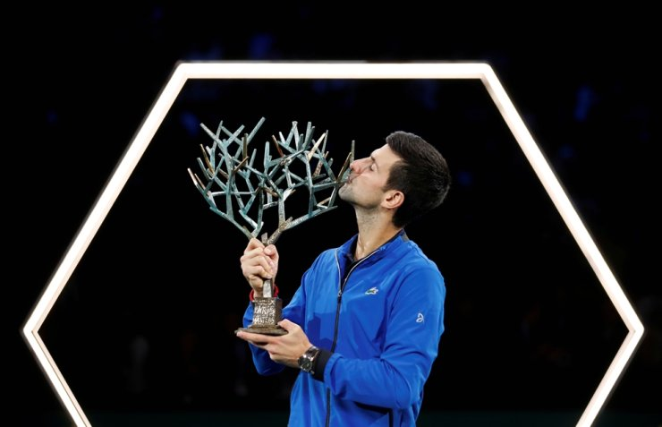 Serbia's Novak Djokovic celebrates with the trophy after winning the Paris Masters at AccorHotels Arena in Paris, France, Sunday. Reuters-Yonhap