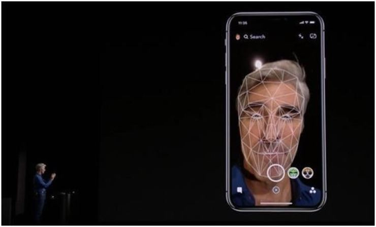 Apple's Senior Vice President Craig Federighi demonstrates 'Face ID' authentication technology during the launch ceremony of iPhoneX at Steve Jobs Theater in California in September 2017. / Screen capture from Apple's Youtube channel
