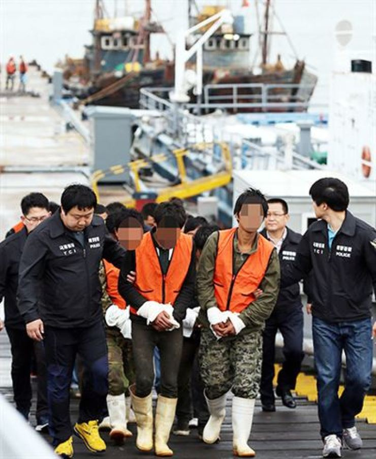 Chinese fishermen are taken by South Korean maritime police for questioning after illegally fishing in waters off Ganghwa Island near Incheon, June 2016. Yonhap
